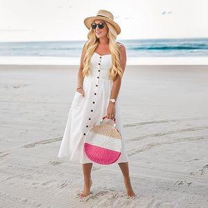 Dresses & Skirts - White button through midi dress with pockets